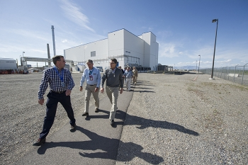 Integrated Waste Treatment Unit (IWTU) Operations Project Manager Craig Olson, left, discusses IWTU operation issues with Energy Secretary Rick Perry, right, and Fluor Idaho Program Manager Fred Hughes, center.