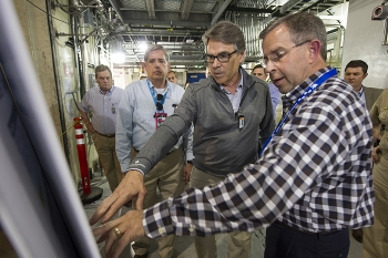 Integrated Waste Treatment Unit (IWTU) Operations Project Manager Craig Olson, right, discusses a newly redesigned component of the IWTU with Energy Secretary Rick Perry, center right; Fluor Idaho Program Manager Fred Hughes, center left; and U.S. Rep. Mike Simpson (Idaho), left.