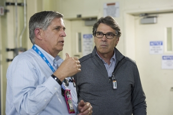 Fluor Idaho Program Manager Fred Hughes, left, describes Integrated Waste Treatment Unit operations to Energy Secretary Rick Perry.