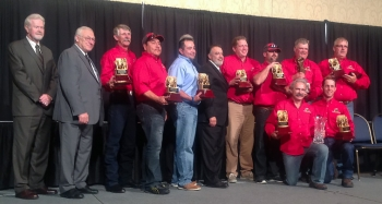 CBFO Manager Joe Franco (sixth from left) with the WIPP Red Team and competition officials at the 2014 National Metal and Nonmetal Mine Rescue Competition.