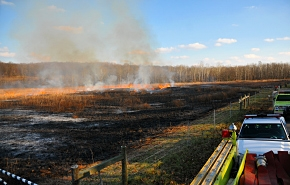 Firefighters keep watch as the controlled prairie burn is completed at the Portsmouth Site.
