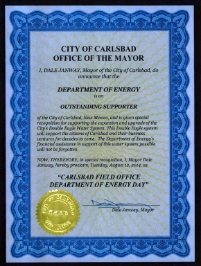 """Carlsbad Mayor Dale Janway proclaimed Aug. 12, 2014 """"Carlsbad Field Office Department of Energy Day"""" in recognition of the DOE's support of the city's Double Eagle Water System, which will provide additional water for the expanding city. """"I'm proud of the work you do and the support you continue to provide to the city, the nation, and the world,"""" CBFO Manager Joe Franco told employees. """"I very much appreciate your hard work, dedication, and perseverance as we move forward through our Waste Isolation Pilot Plant recovery phase."""""""