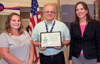 DOE Carlsbad Field Office (CBFO) Deputy Manager Ed Ziemianski presents the Green Zia Program Silver Level Leader award from the New Mexico Environment Department. Ziemianski is shown with Lynn Johnson (left), of Washington TRU Solutions LLC, the Waste Isolation Pilot Plant (WIPP) management and operating contractor, Regulatory Compliance, and CBFO Environmental Protection Specialist Susan McCauslin, program lead for the WIPP team.