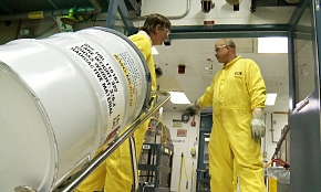 Workers relocate a pipe overpack container used to transport small amounts of excess plutonium oxide destined for long-term storage at the Waste Isolation Pilot Plant in Carlsbad, New Mexico.