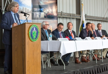 Employees from CBFO, associated DOE contractors and laboratories, elected officials, WIPP stakeholders, and leaders from New Mexico communities attended a meeting at WIPP where the Secretary (at podium) addressed the group and answered questions. Seated from left: DOE Deputy Under Secretary for Management and Performance David Klaus; Franco; U.S. Sens. Tom Udall and Martin Heinrich (N.M.); U.S. Rep. Steve Pearce (N.M.); and Bob McQuinn, president and project manager of Nuclear Waste Partnership (NWP), the WIPP management and operating contractor.