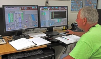 Nuclear Chemical Operator Mike Fish monitors operations of a pump-and-treat system at the Hanford site.