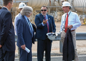The Secretary (second from left) discusses the ventilation system at WIPP with Franco (center) and Udall (right). EM Acting Assistant Secretary Mark Whitney is on the far left.