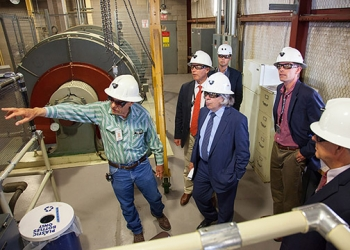 Norm Siepel of NWP explains salt hoist operations to the Secretary (center, foreground); Udall (second from left); Heinrich (second from right); Pearce; and Jonathan Black of Udall's office (far background).