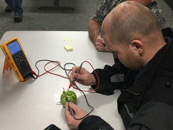 "Students, including engineers and electricians, attending a DOE Training Institute battery safety training at Idaho National Laboratory create ""batteries"" using fruits and vegetables and dissimilar metals."