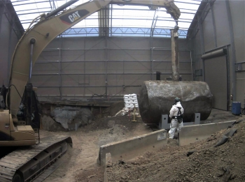 Workers remove the 4,000-gallon Tank W-1A, which was ORNL's greatest source of groundwater contamination.