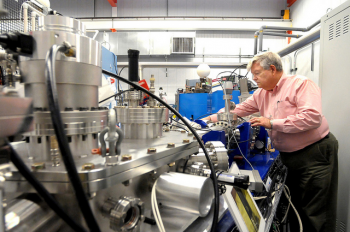 Argonne physicist Richard Pardo stands next to CARIBU | Photo Courtesy of ANL's Flickr page.