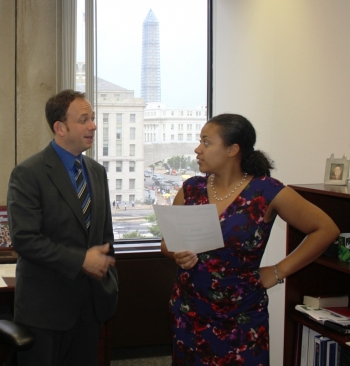 EM Office of External Affairs Acting Communications Director Dave Borak talks with EM intern Valerie Edwards.