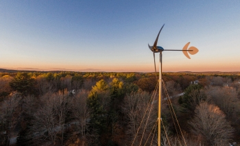 Unlike utility-scale wind turbines that can have blades longer than a football field, this Pika Energy T701, three-bladed, 1.5-kilowatt turbine is an example of an affordable small-wind system option to offset energy usage.   Photo courtesy Pika Energy