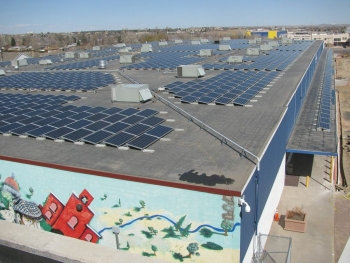 The installation of this 2,244-panel photovoltaic system on Pinnacle Charter School in Denver, Colorado was fully funded by 456 American investors in 10 days. The project is expected to save the school $1.6 million in electricity costs over the next ten years.| Photo courtesy of Mosaic