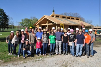 "Purdue's INhome team at their recent ""Topping Out"" party (note the little tree on the roof of the house). 