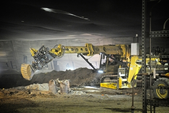 Workers exhume buried transuranic waste from Pit 9.