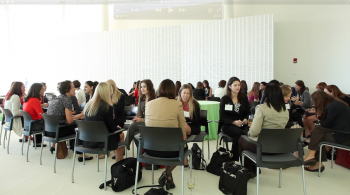 """A scene from a """"speed networking"""" session held at the symposium. Fostering a sense of community for women in the clean energy sector is a key focus of C3E.   Photo by Matty Greene."""
