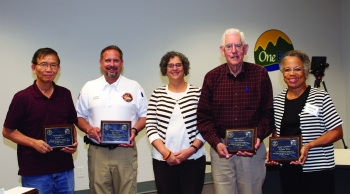OREM Manager Sue Cange (center), with retiring ORSSAB members (from left) Donald Mei, Scott Stout, Bob Hatcher, and Alfreda Cook.