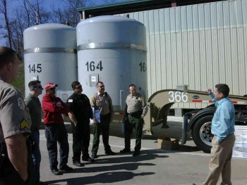 Bobby St. John of Nuclear Waste Partnership, the management and operations contractor for the Waste Isolation Pilot Plant site, briefs local law enforcement and fire service employees on the features of the TRUPACT II container used to move contact handled transuranic waste to the site.