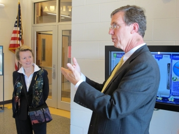 Roya Stanley (left) on a tour of the Snipes Academy of Arts and Design with the building's architect -- Thomas Hughes. Through interactive real-time energy data tools, Snipes students incorporate energy use data in their classroom projects and studies. | Photo Courtesy of the Cape Fear Green Building Alliance.