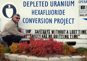 Russ Hall, environment, safety and health supervisor, changes the DUF6 project sign to mark five years without a lost-time accident.