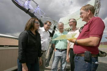 NREL's Ultra-Accelerated Weathering System tests products for outdoor durability. (left to right), Judy Netter, NREL; Henry Hardcastle, Atlas Material Testing Technology; and Al Lewandowski, Gary Jorgensen and Carl Bingham of NREL. | Photo Courtesy of Joe Poellot