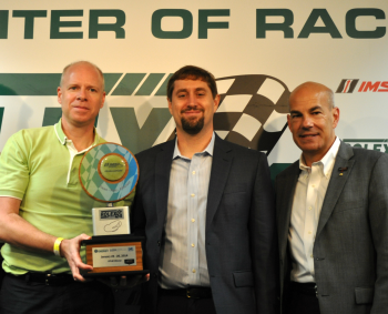 Karl Simon (from left) the Environmental Protection Agency's Director of Transportation and Climate Division for the Office of Transportation and Air Quality; Michael Carr, the Energy Department's Principal Deputy Assistant Secretary for the Office of Energy Efficiency and Renewable Energy; and Scott Atherton, President of International Motor Sports Association; pose with the Green Racing Challenge award at the Rolex 24 at Daytona event last weekend. |  Photo by Natalie Committee, Energy Department