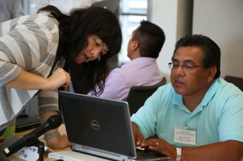 Workshop attendees received hands-on training from NREL technical experts on how to use a free online tool called the System Advisor Model to make informed decisions about renewable energy development. Photo by John De La Rosa, NREL