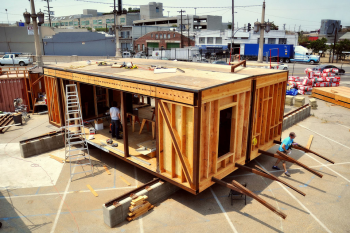 The Southern California Institute of Architecture and California Institute of Technology team's 10-month design process resulted in their unique design -- a house made of two prefab modules and canopies that run on a system of rails.   Photo courtesy of SCI-Arc/Caltech.