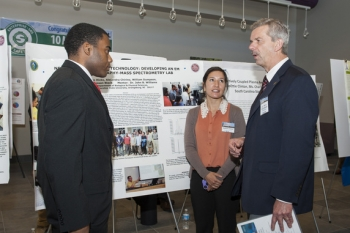 South Carolina State University students William Dumpson, left, and Alejandra Chirino, center, talk with Savannah River National Laboratory Director Dr. Terry Michalske at a recent research exchange involving the laboratory and seven historically black colleges and universities.