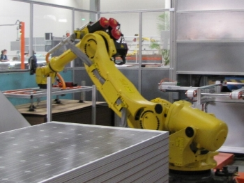 A robot works on crystalline solar cells at Wisconsin-based Helios USA, LLC. The opening of the manufacturing plant has supported 26 jobs and is projected to create a total of 50 permanent jobs in the state and was supported through a State Energy Program loan.   Courtesy of Helios USA, LLC.
