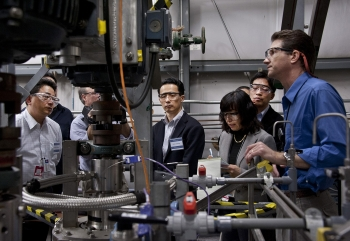 Savannah River National Laboratory scientist Dave Herman (right) discusses waste management equipment during a visit by Japanese scientists involved in the cleanup at Japan's Fukushima nuclear plant.