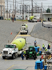 Cement trucks transport a specially formulated grout that is pumped into two underground waste tanks at the Savannah River Site as part of work to close the massive structures.