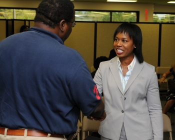 Karl Fraiser, a member of the Savannah River Special Emphasis Planning Committee, meets with Dot Harris at the site's Women's Equality Day Celebration.   Photo by Rob Davis, Savannah River Site.