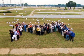 Employees of the Savannah River Site's M Area Operable Unit (MAOU) gather at the completed site.