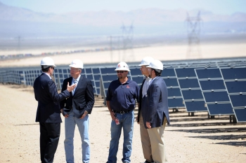 Secretary of the Interior Ken Salazar speaks with First Solar and Enbridge leadership at the Enbridge Silver State North solar project in Nevada. | Photo courtesy of Interior Department, credit Tami A. Heilemann.