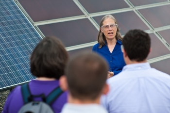 NREL Principal Scientist Sarah Kurtz leads a tour of the Outdoor Testing Facility for the Congressional Staff at The National Renewable Energy Laboratory (NREL). (Photo by Dennis Schroeder / NREL)