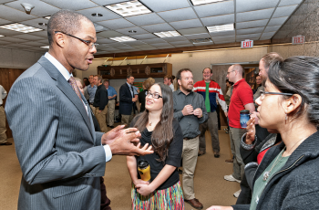 Assistant Secretary Chris Smith meets with UT undergraduate students studying geological research.   Photo by David M. Stephens, The University of Texas at Austin.