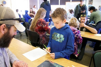 Parents played an important role in the Museum of Idaho – Fluor Idaho's Engineering Day by helping their children understand engineering design can be fun.