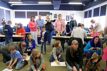 """The intensity of kids and parents creating catapults can be seen in this """"bulls eye"""" view of the launch action at the Museum of Idaho – Fluor Idaho's Engineering Day."""