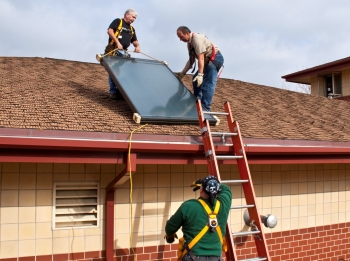 Installing a solar hot water system at a Milwaukee fire station. The installation was completed as part of the Midwest Renewable Energy Association's hands-on training workshop. System components were donated by local manufacturer, Caleffi.   Photo Courtesy of the National Renewable Energy Lab.