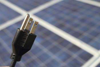 A plug-and-play PV system is envisioned as a consumer friendly solar technology that uses an automatic detection system to initiate communication between the solar energy system and the utility when plugged into a PV-ready circuit.   Photo by iStock.