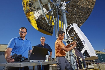 Pacific Northwest National Laboratory's prototype thermochemical conversion device, funded by EERE and a natural gas company, is installed in front of a concentrating solar power dish. The device converts natural gas into the more energy-rich fuel syngas. Small clean tech businesses may be interested in technical assistance related to system components, the process itself, or downstream products such as hydrogen, methanol, or chemicals.