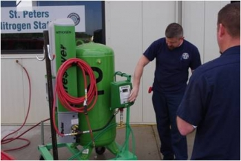 Workers demonstrate the nitrogen tank used to inflate tires in St. Peters, MO.   Courtesy of the City of St. Peters
