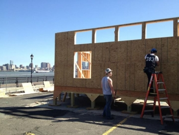 With a spectacular view of the New York City skyline, students from the Stevens Institute of Technology spent more than three months on the Hoboken Waterfront building their house, Ecohabit, and they considered it a learning process for everyone.   Photo courtesy of Stevens.