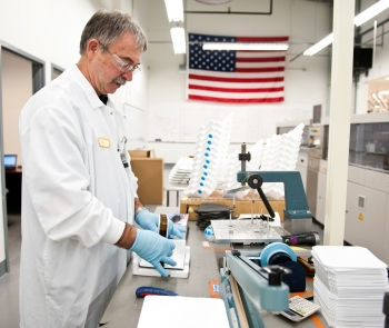 Suniva employee doing quality assurance testing at its Georgia headquarters. Photo Courtesy: Suniva