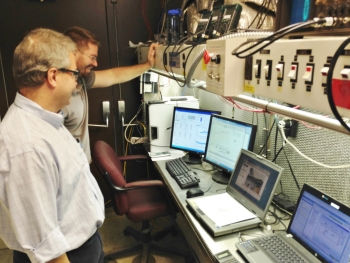 Mechanical Solutions, Inc.'s Supercharger could break open a major new market for heat pumps: cold climates. Here, MSI engineers Peter Chapman and Andrew Rogers monitor a Supercharger test in progress.