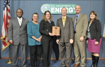 Award ceremony (left to right): Melvin G. Williams, Jr., Associate Deputy Secretary, U.S. Department of Energy (DOE); Mary Sizemore, Environmental Management System (EMS) Coordinator, Office of Legacy Management (LM) contractor; Tracy Ribeiro, EMS Coordinator, LM; Tom Pauling, Director of Site Operations, LM; Dave Geiser, Director, LM; and Jennifer MacDonald, Director, Sustainability Performance Office, DOE.