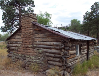 A present-day photo of the Pond Cabin at Los Alamos National Laboratory. Built in 1914, it was used to support plutonium chemistry research.