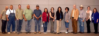 Participants in the effort to revegetate a portion of land at the Nevada National Security Site gather for a photo. From left to right: Jeremy Spoon, Portland State University; Maurice Frank-Churchill, Duckwater Shoshone Tribe; Michael Clifford, Desert Research Institute; Ross Stone, Big Pine Paiute Tribe; Kenny Anderson, Las Vegas Paiute Tribe; Barbara Durham, Timbisha Shoshone Tribe; Alissa Silvas, National Security Technologies; Danelle Gutierrez, Big Pine Paiute Tribe; Betty Cornelius, Colorado River Indian Tribes; Scott Wade, Nevada Field Office; Richard Arnold, Pahrump Paiute Tribe, Consolidated Group of Tribes and Organizations spokesperson; Kate Barcalow, Portland State University; and Colleen Beck, Desert Research Institute.